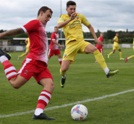 First-half - Callum Saunders closes on the ball