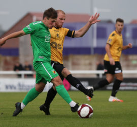 First-half - Sean Cooke on the ball under pressure from Southport
