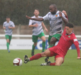 First-half - Joe Mwasile is challenged for the ball